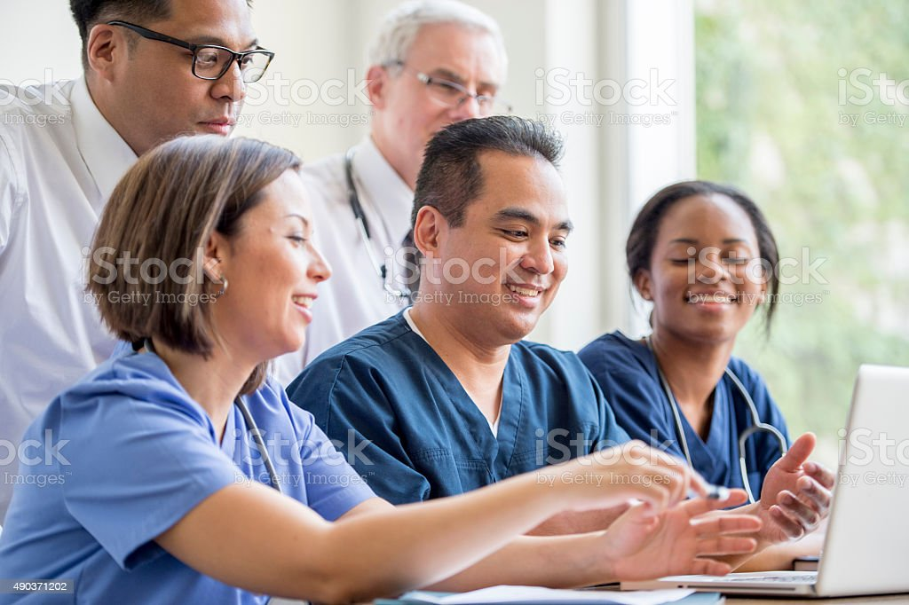 Group of Healthcare Professionals Doing Research stock photo