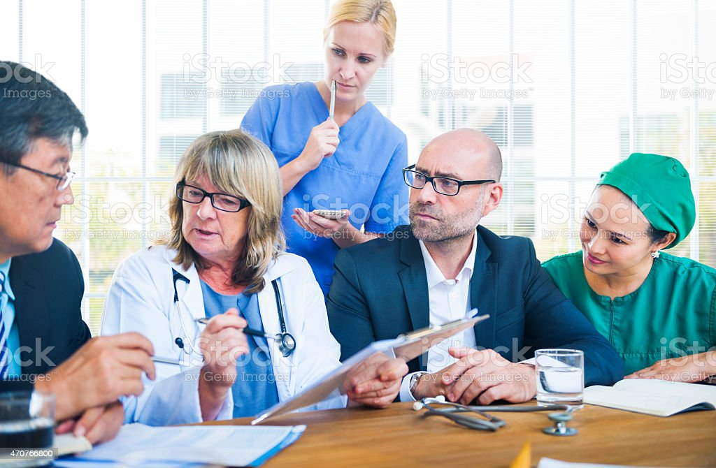 A group of healthcare workers having a meeting stock photo