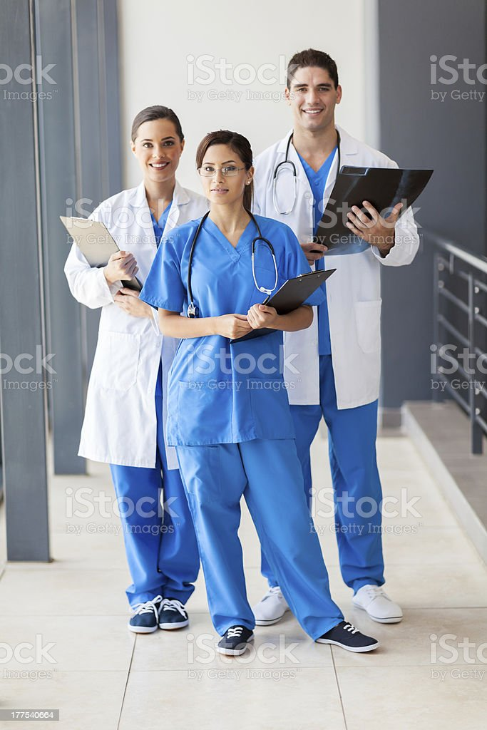 A group of healthcare workers posing for a photo stock photo