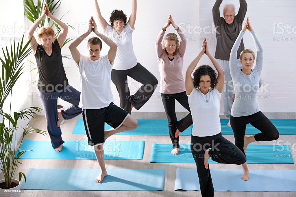 Group of healthy people practicing yoga stock photo