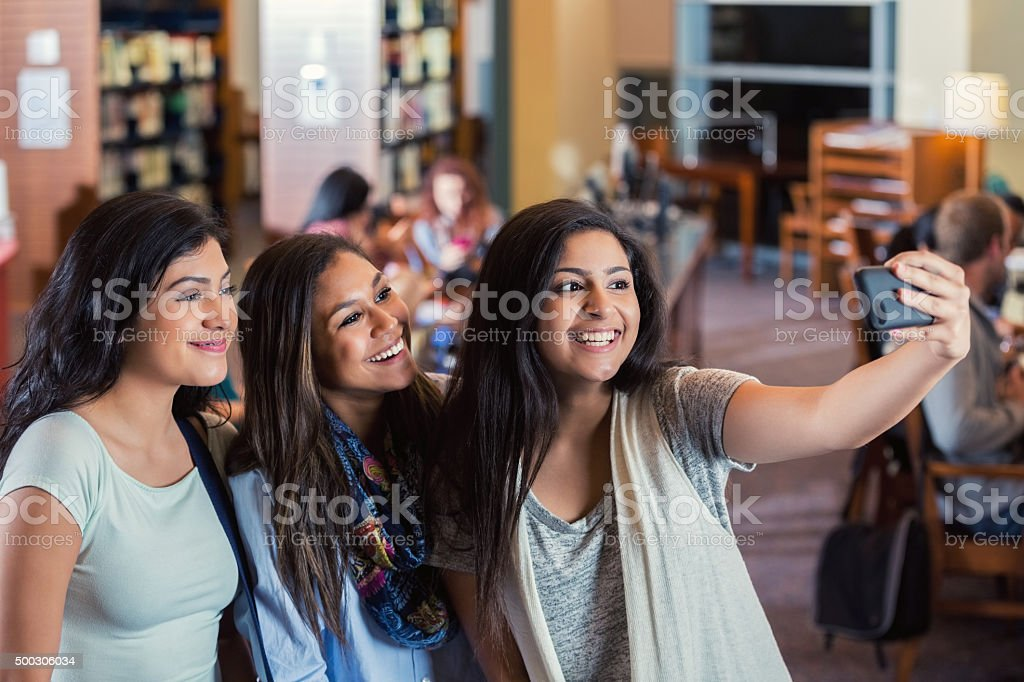 Group of high school girls taking selfie photo together stock photo