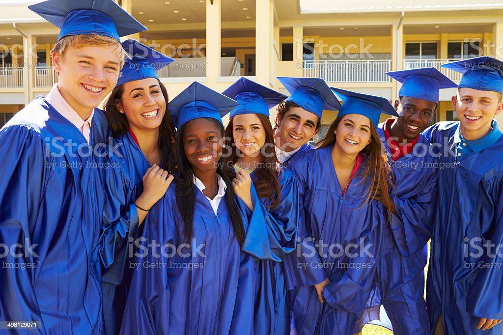 Group Of High School Students Celebrating Graduation stock photo