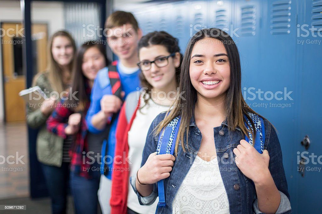 Group of high school students posing together stock photo