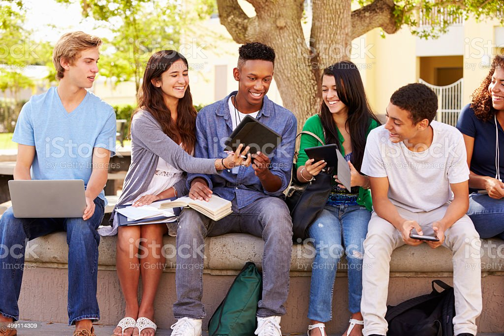 Group of high school students working on project stock photo