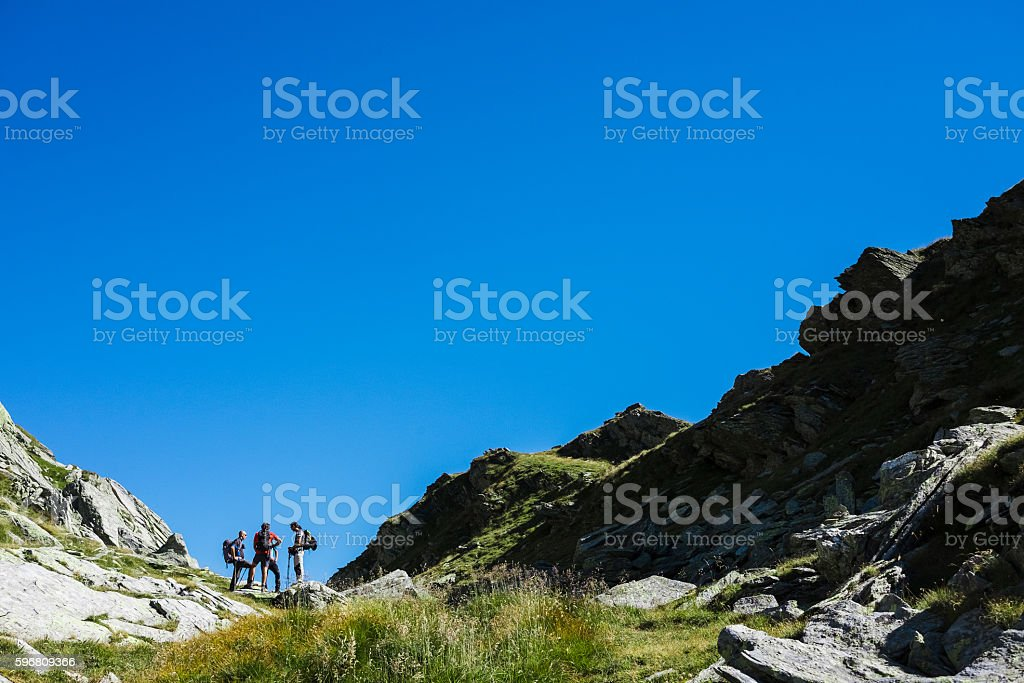 Group of hiker on mountain trail stock photo