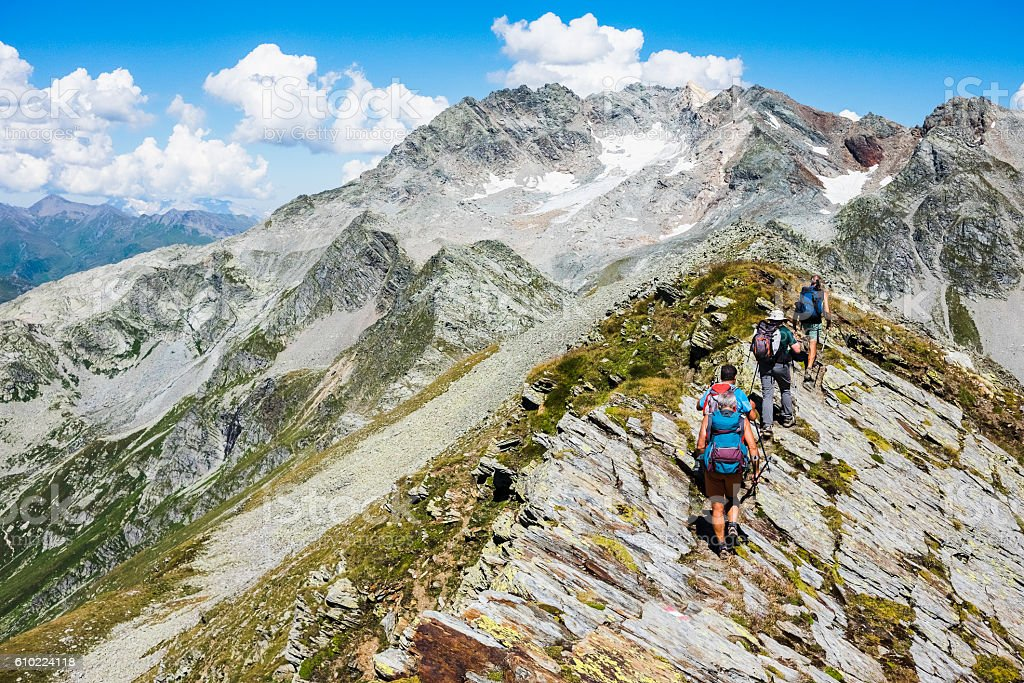 Group of hiker on top of the  mountain trail stock photo