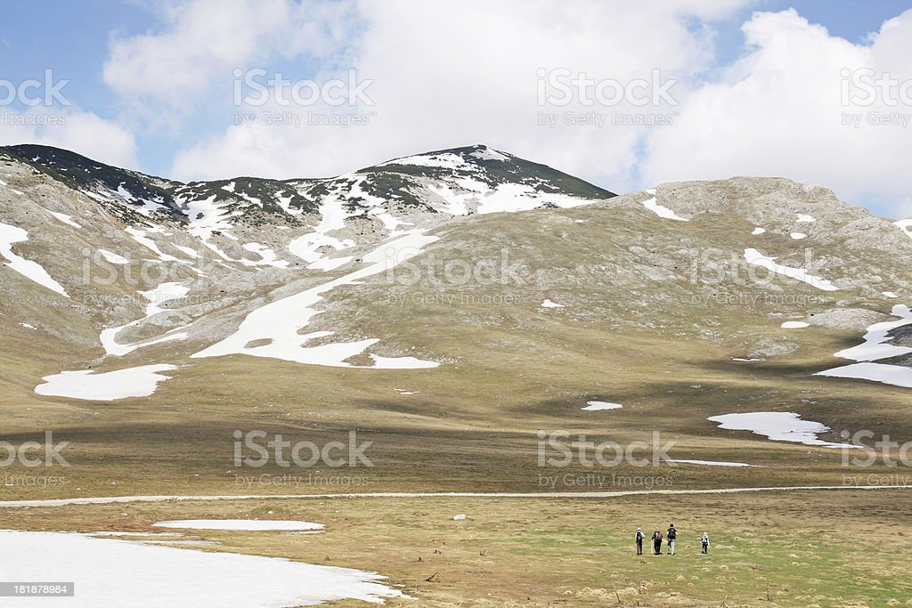 Group of Hikers going on the Mountain top royalty-free stock photo