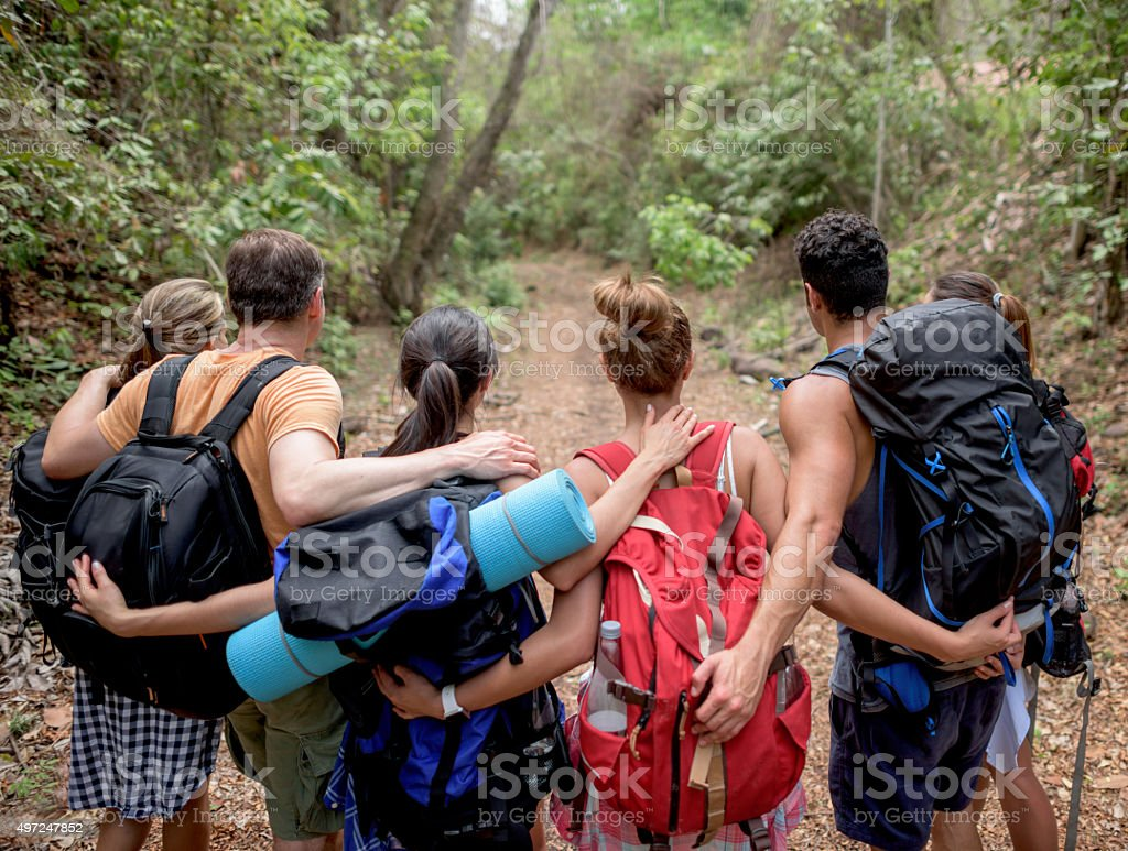 Group of hikers hugging stock photo