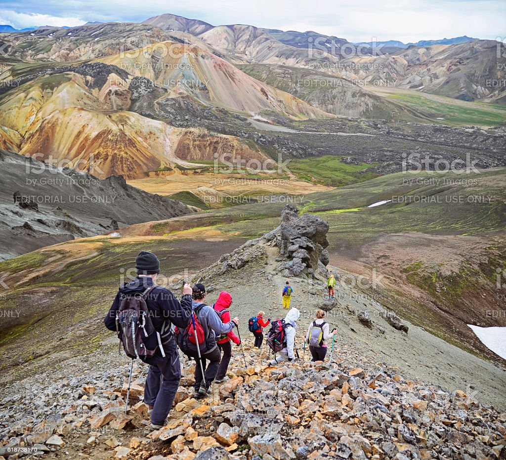 Group of hikers in the mountains . Icelandic landscape stock photo