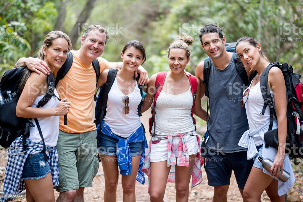 Group of hikers looking very happy outdoors stock photo