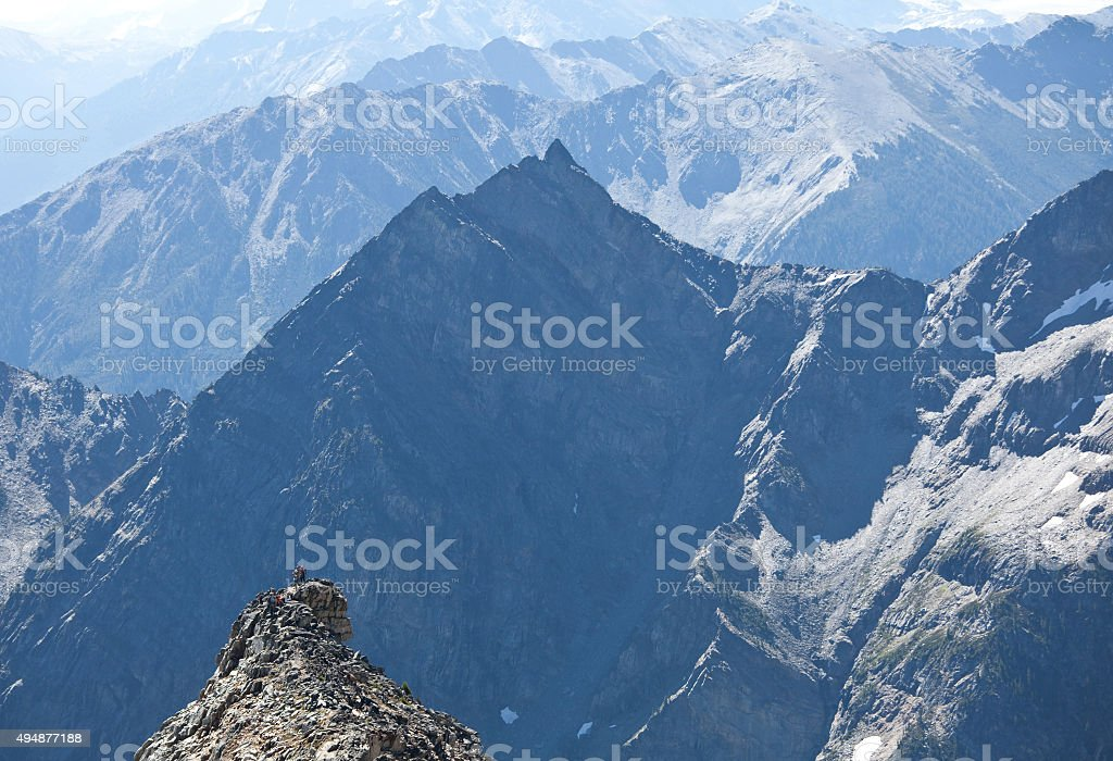 Group of Hikers on Distant Peak in the Purcell Mountains stock photo