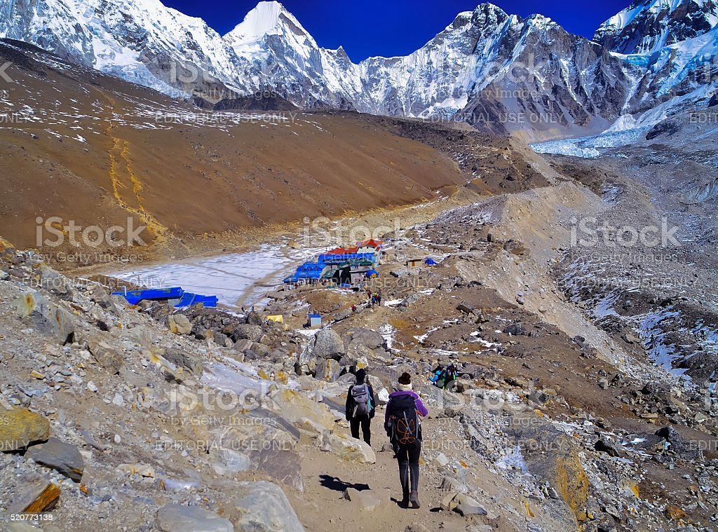 Group of hikers  with backpack  in Himalayas stock photo