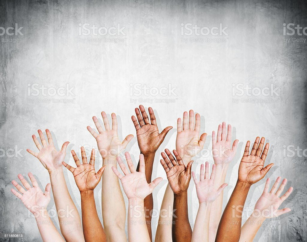 Group of Human Arms Raised with Concrete wall stock photo