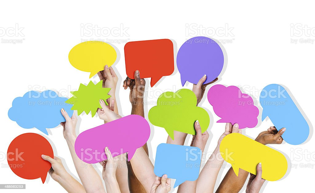 Group of Human Arms Raised with Speech Bubble stock photo