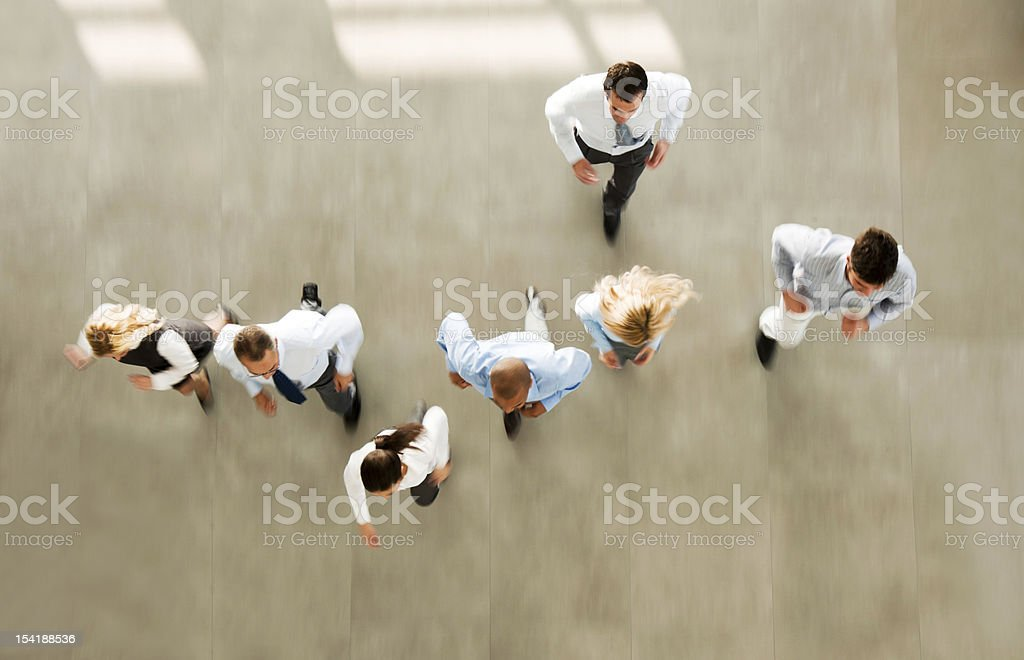 Group of hurry businesspeople entering the building. stock photo