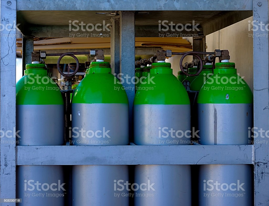 group of industrial gas cylinders stock photo