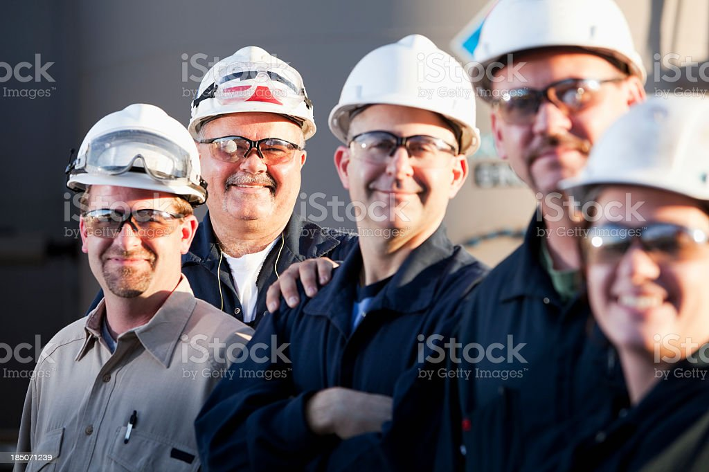 Group of industrial workers wearing hardhats royalty-free stock photo