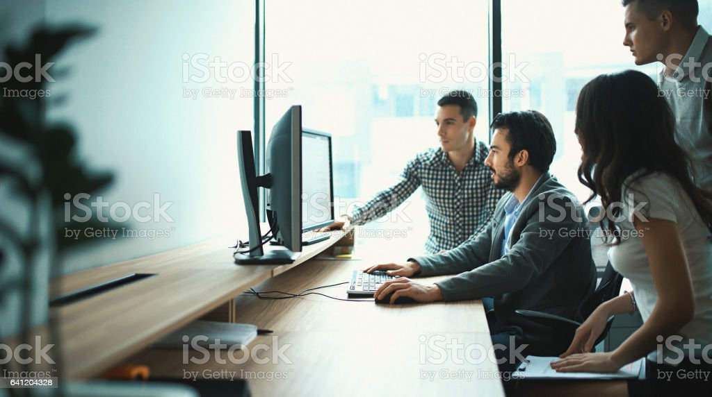 Group of IT experts in their office. stock photo