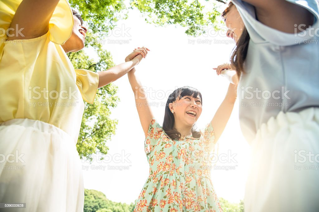 Group of japanese friends togetherness enjoy stock photo