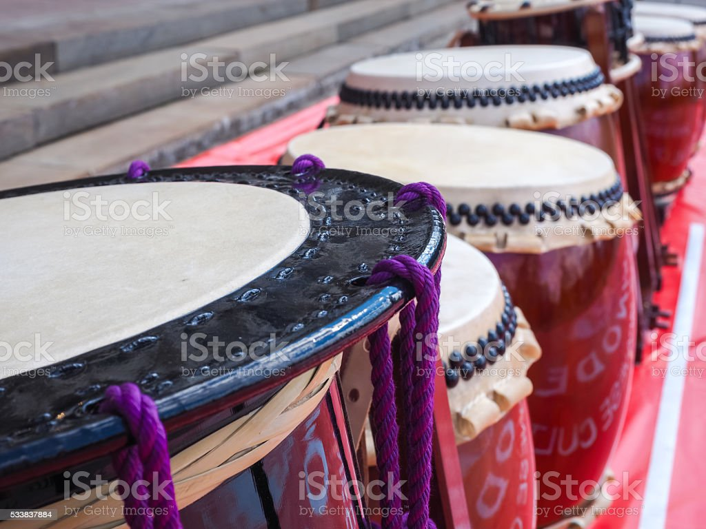 Group of japanese musicians are playing on Taiko drums. stock photo