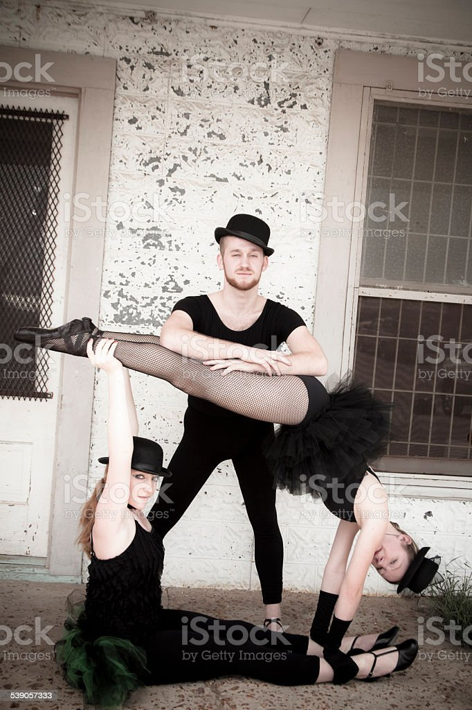 Group of jazz ballet dancers wearing costume pose for camera. stock photo