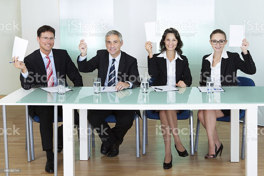 Group of judges holding up blank cards stock photo