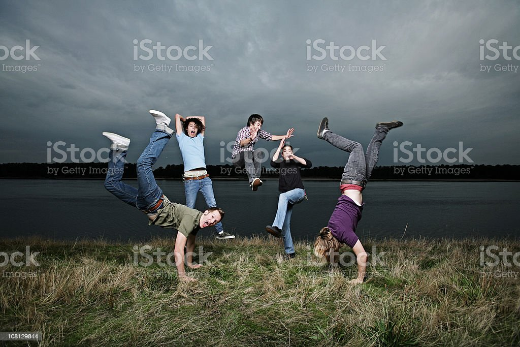 Group Of Jumping Guys by River royalty-free stock photo