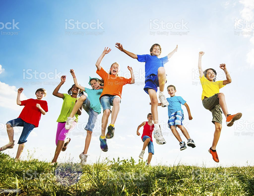Group of kids having fun outdoors. stock photo