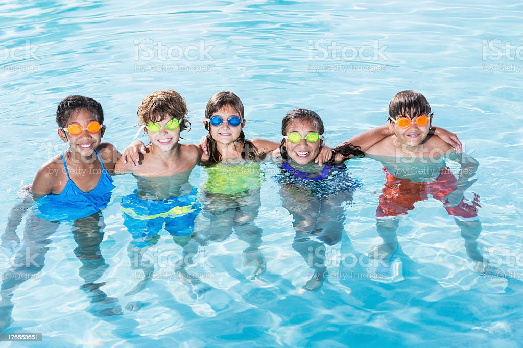 Group of kids in swimming pool royalty-free stock photo