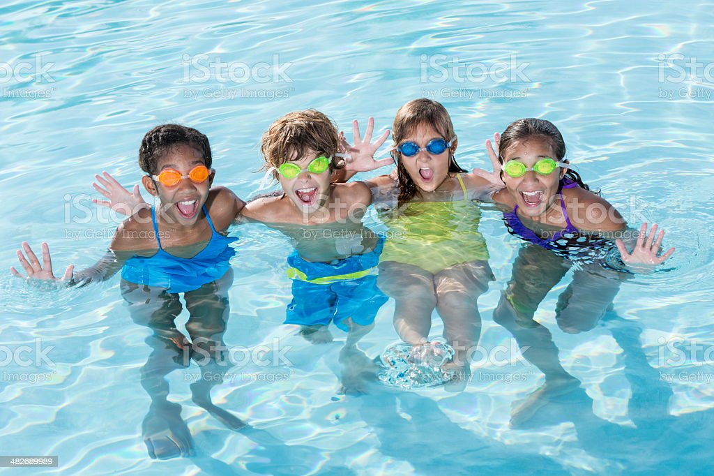 Group of kids in swimming pool stock photo