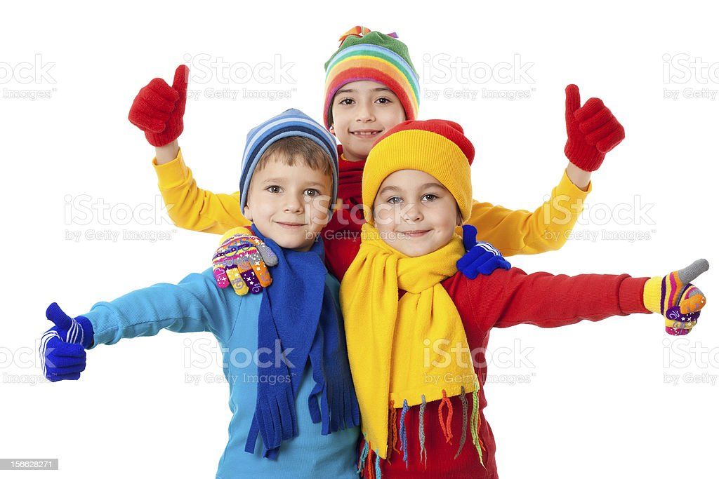 Group of kids in winter clothes and ok sign royalty-free stock photo