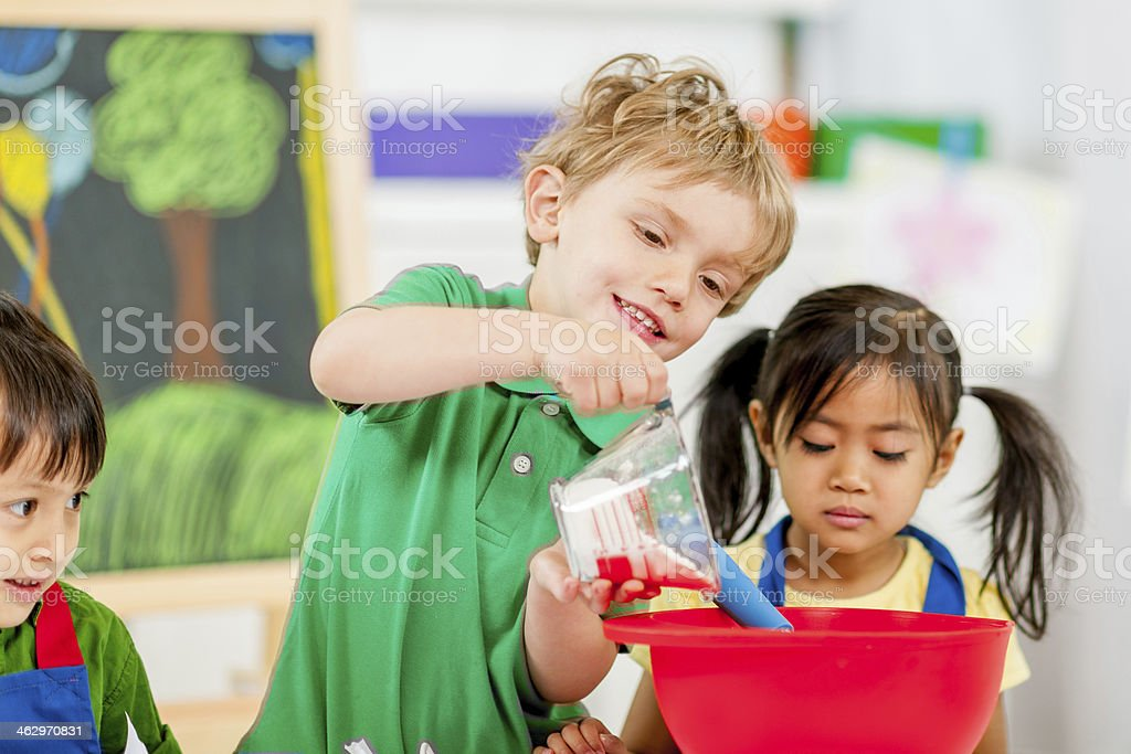 Group of kids making cookies stock photo