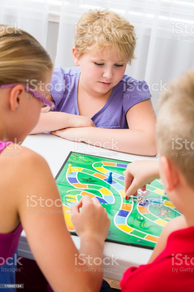 Group of kids playing a board game royalty-free stock photo