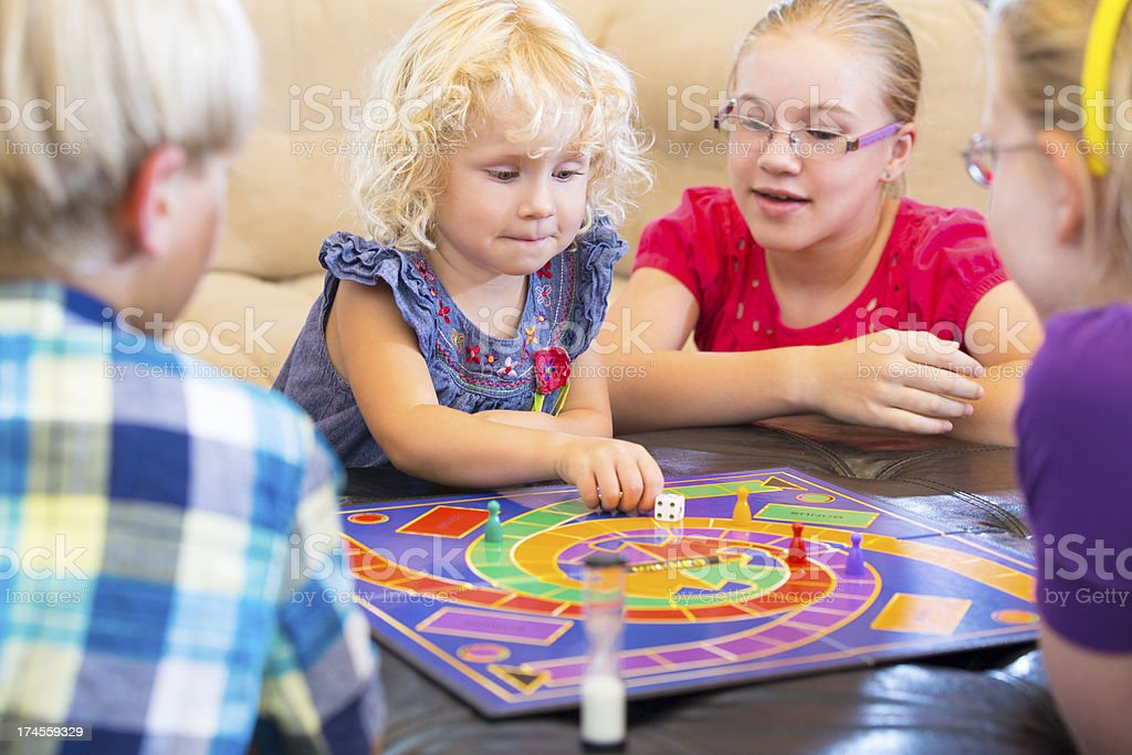 Group of kids playing a board game stock photo