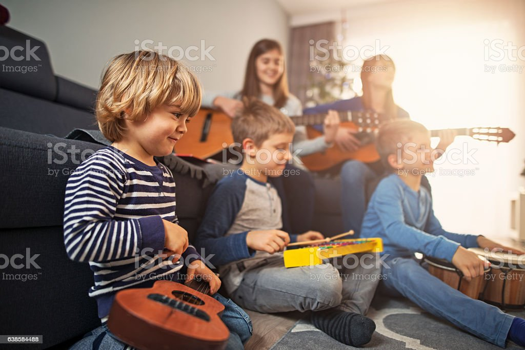 Group of kids playing music together stock photo