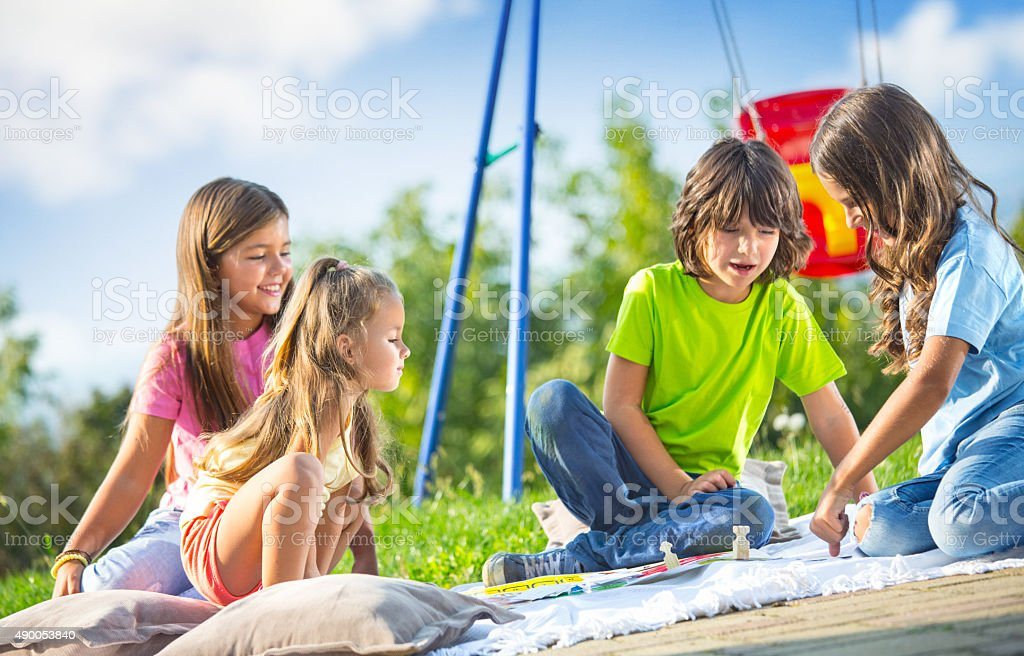 Group of kids playing outdoors. stock photo