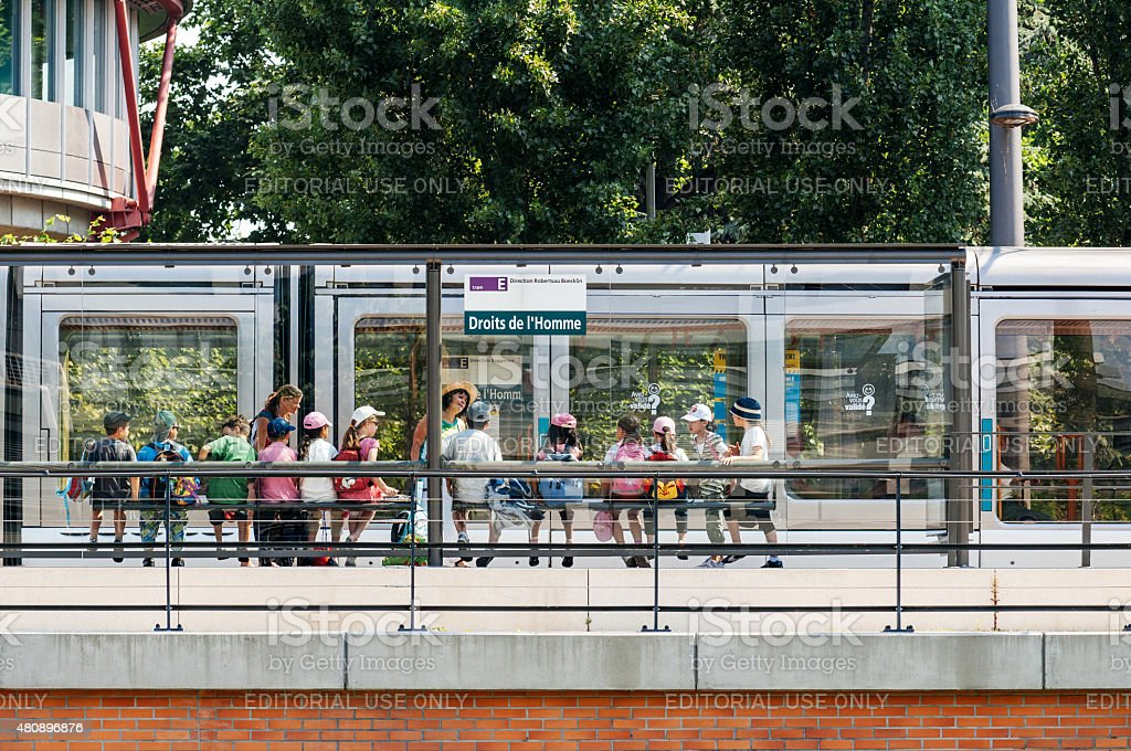 Group of kids waiting tram at Human Rights Station stock photo