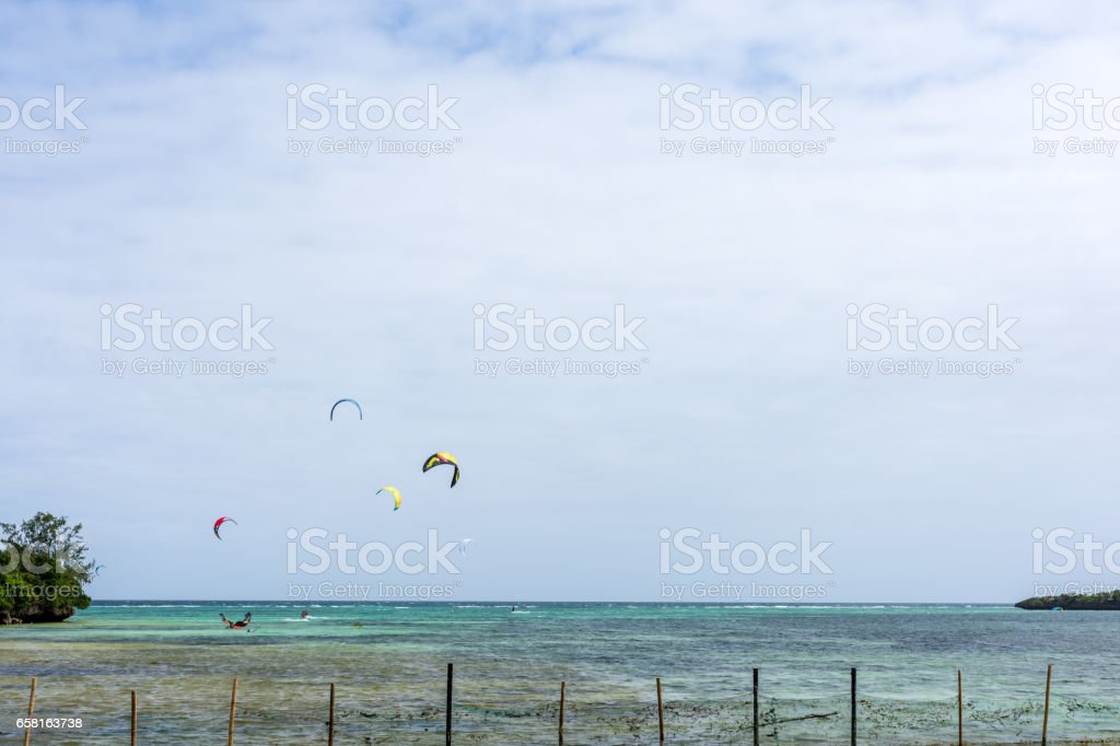 A group of kite surfs far out surfing stock photo