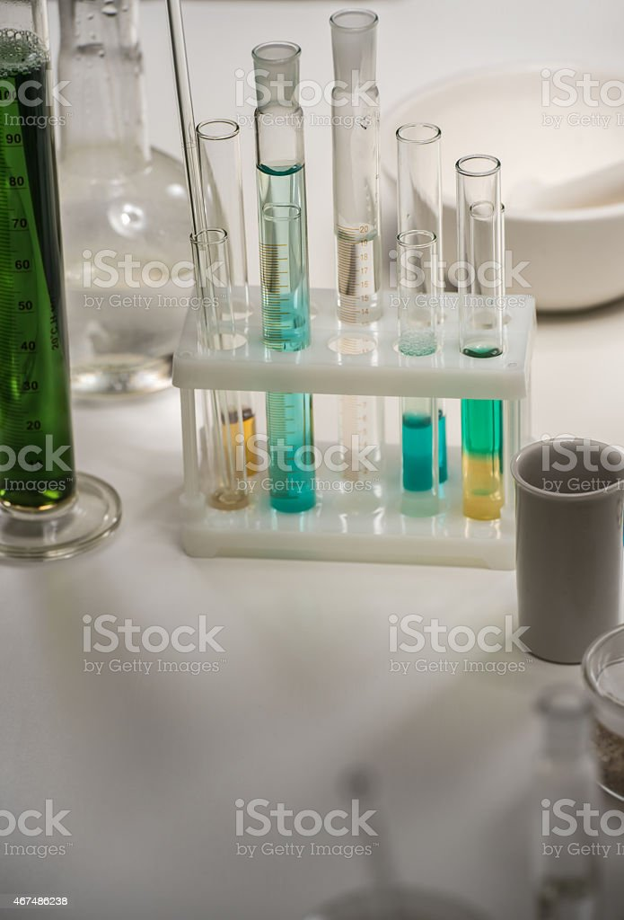 Group of laboratory flasks with liquid on table stock photo