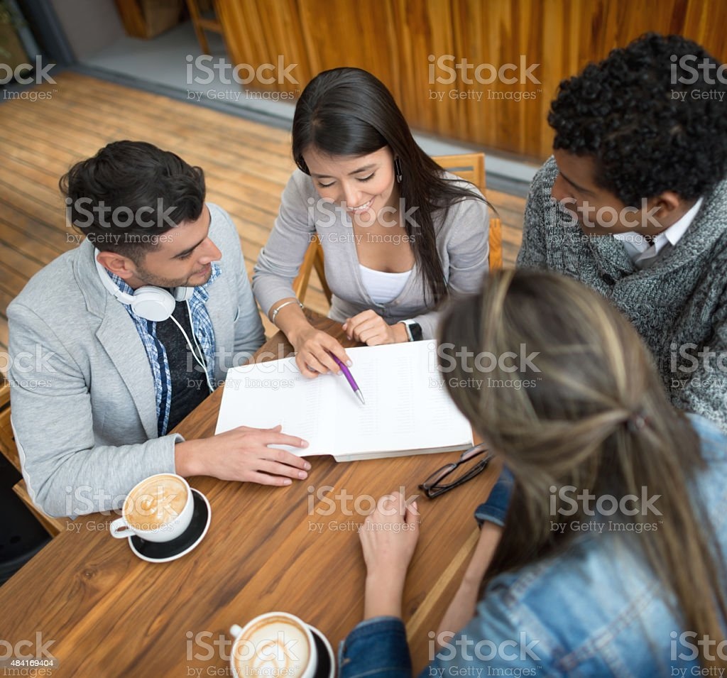 Group of Latin students studying together stock photo