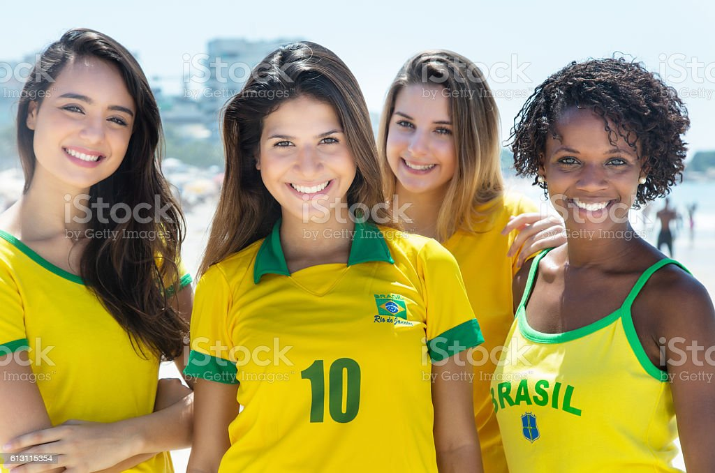 Group of laughing brazilian soccer fans stock photo