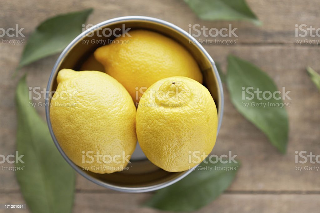 Group of lemmons in a tin. stock photo
