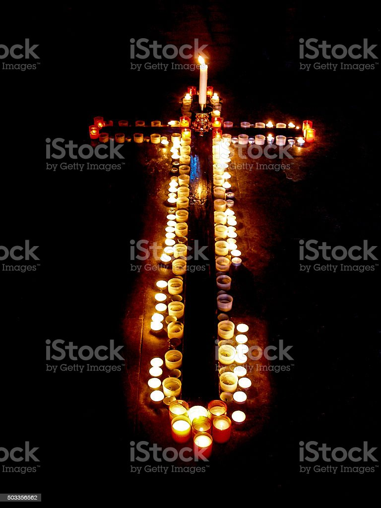 Group of Lit Votive Candles in Cross Shape, Black Background stock photo