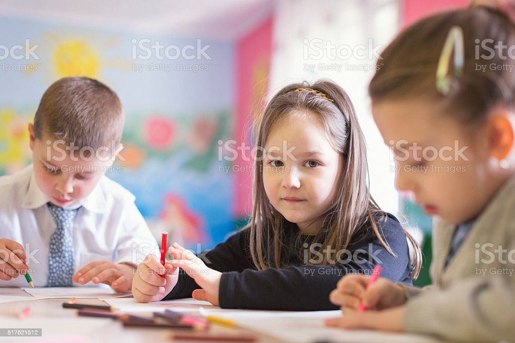 Group of little children drawing stock photo