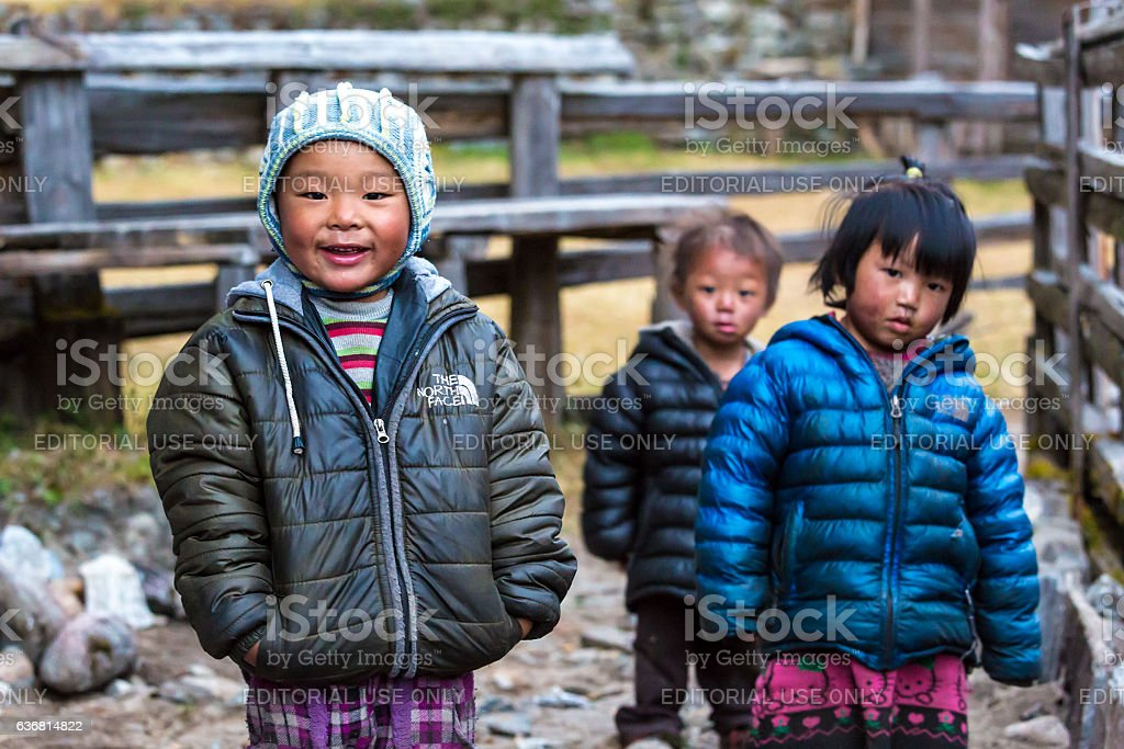 Group of little Children in remote Himalaya Village stock photo