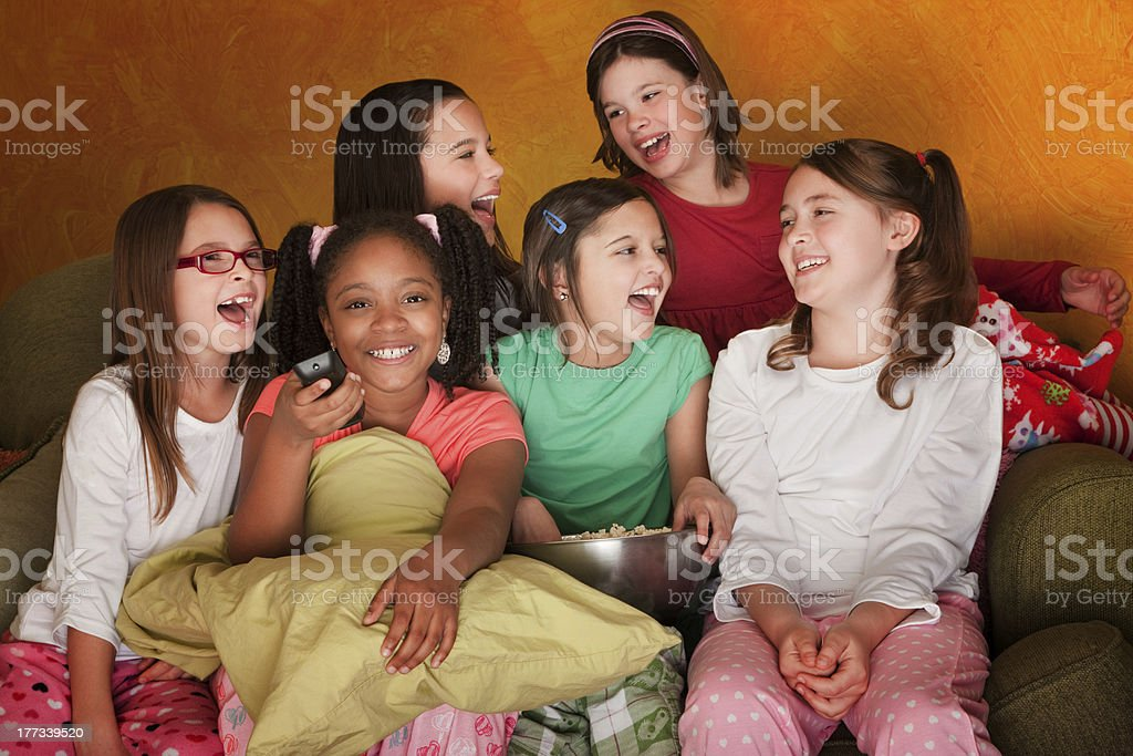 Group Of Little Girls Watch Television stock photo