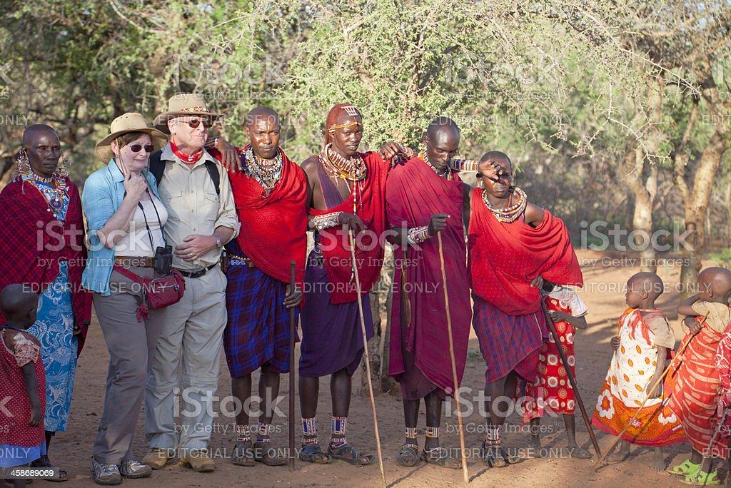 Group of maasai and tourists stock photo