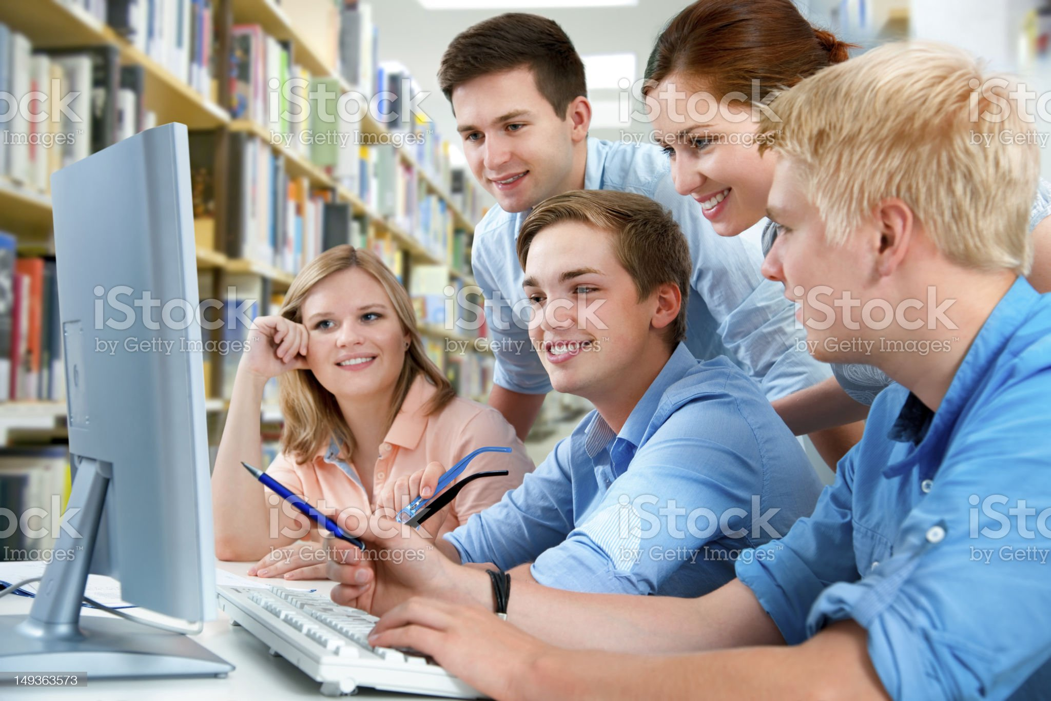 Group of male and female students studying together royalty-free stock photo