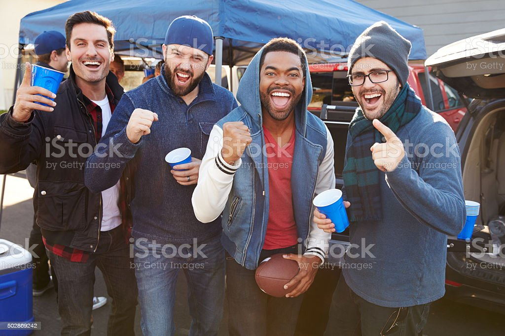 Group Of Male Sports Fans Tailgating In Stadium Car Park stock photo