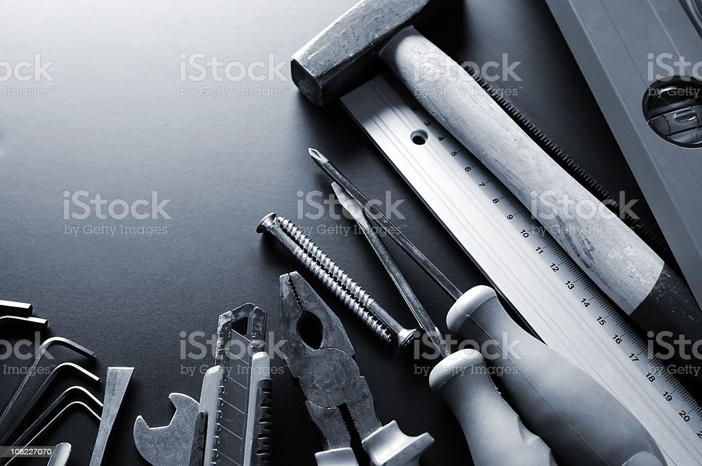 Group of many different construction tools, blue toned, copy space stock photo